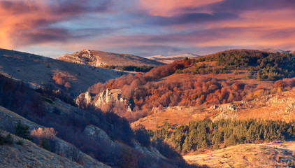 Beautiful autumn sunset in the Crimea mountains.