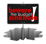 Beware the Budget Sinkhole Sign Hole Money Trouble Bankruptcy poster