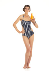 Full length portrait of happy young woman in swimsuit