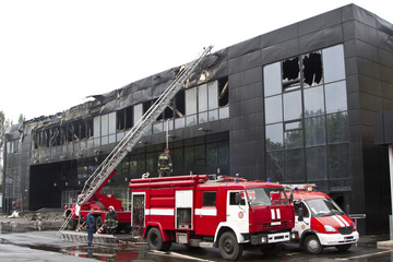 Two fire engines near the sports complex Donbass after the fire