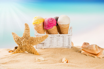 Ice cream scoops on sandy beach.