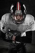 american football player on dark background