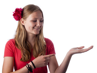 Happy teenage girl showing something on the palm of her hand
