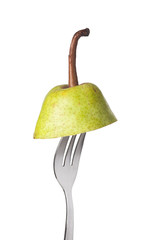 Section of a pear held by a fork isolated on white background