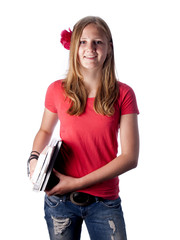 Young female teenage student carrying books over white