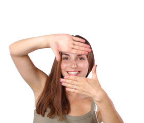 Young attractive woman framing her hands