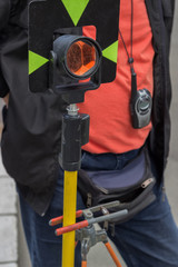 theodolite prism with survey worker in background
