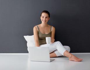 Attractive caucasian girl sitting on floor