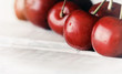 sweet ripe cherries on white wooden table with water drops macro
