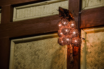 lamp in coconut Shell on wood pole