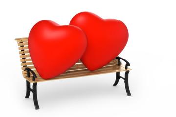 zwei Herzen auf Gartenbank