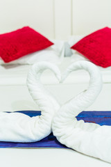 towel swans shaped on the bed