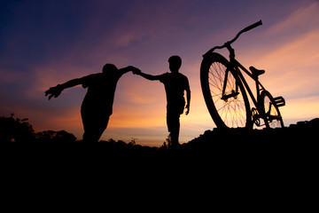 Spirit bicycle silhouette in sunset