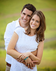a young couple in white, on a green background