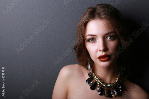 canvas print picture Young beautiful brunette woman in ear-rings, beads