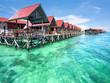 Leinwanddruck Bild - Bungalows on Mabul Island, Sabah, Malaysia
