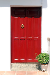 red wooden door with knocker
