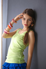 fashionable young woman in summer dress .