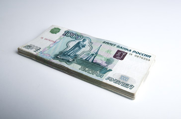 banknotes denominated 1000 rubles on a white