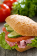 canvas print picture - sandwich with ham and fresh vegetables, selective focus