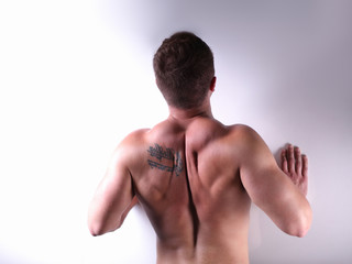 Muscular young man doing press-ups