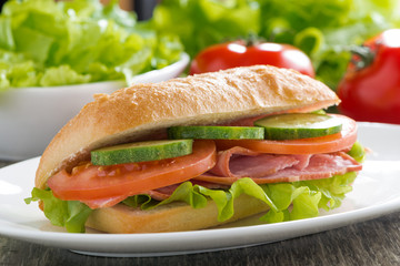 sandwich with ham and fresh vegetables, close-up
