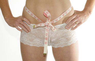 Weight control woman's waist and a tape measure