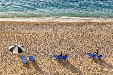 chairs and umbrella on a beach