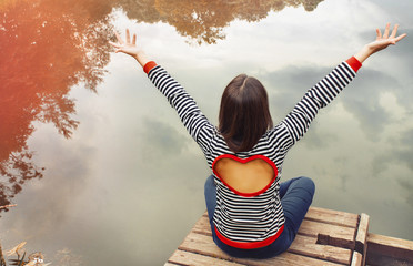cute attractive young woman enjoying harmony of nature near the