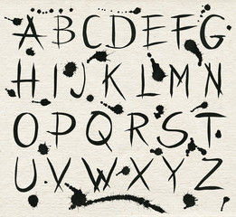 Black ink alphabet letters with splashes.