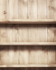 Empty shelf on wooden background. Wood texture.