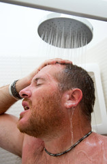 Handsome man in shower