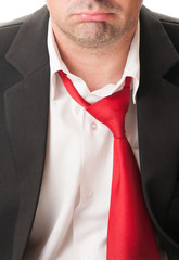 Upset business man with loose tie.
