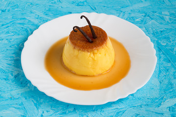 Homemade Creme Caramel with Vanilla Sticks on Top