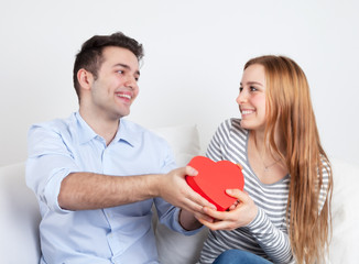 Young man giving a gift to his girlfriend