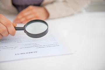 Closeup on business woman exploring document