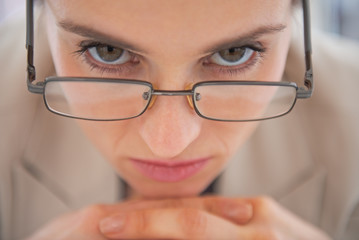 Closeup on business woman wearing eyeglasses