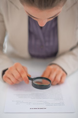 Closeup on business woman exploring document
