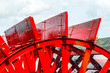 Red Riverboat Paddle Wheel in a River with Trees - 67546160