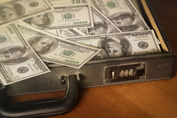 Money in briefcase,vintage style color.