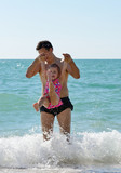 father and toddler girl in sea