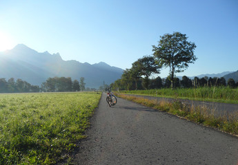 Sunshine on the Bicycle and switzerland summer view background