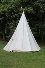 A Traditional White Canvas Bell Shaped Camping Tent.