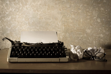 Typewriter with eyeglasses and papers
