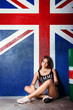 girl sits on the background of the flag of Britain