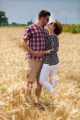 A couple in wheat field.