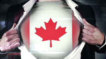Businessman opening shirt to reveal canada flag