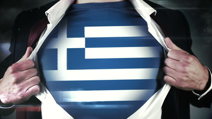 Businessman opening shirt to reveal greek flag
