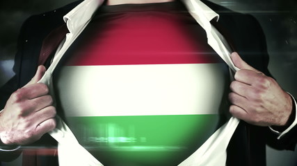 Businessman opening shirt to reveal hungarian flag