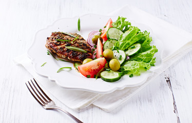 Pork Steak with Salad on a Plate